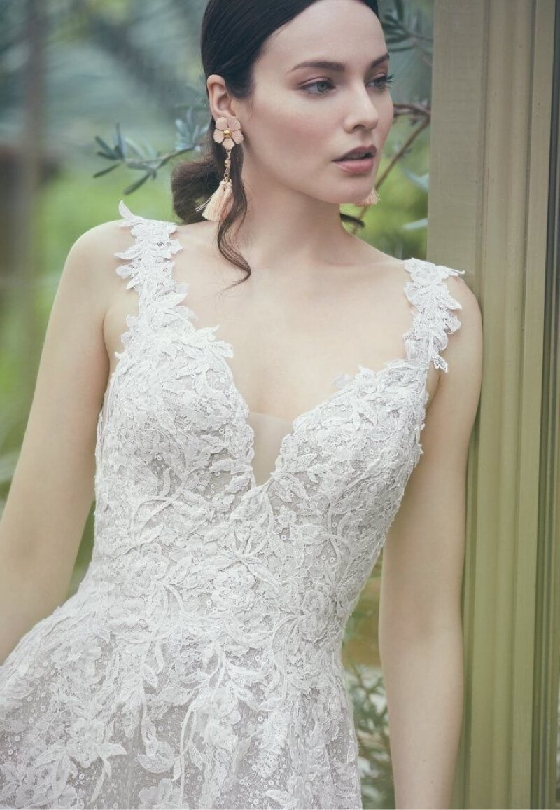 Model wearing white Maggie Sottero dress